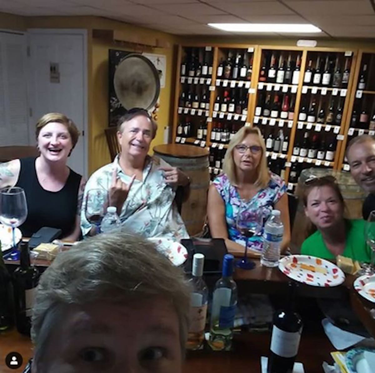 Image of 6 friends at the Casa Jimenez wine shop in Tampa drinking wine